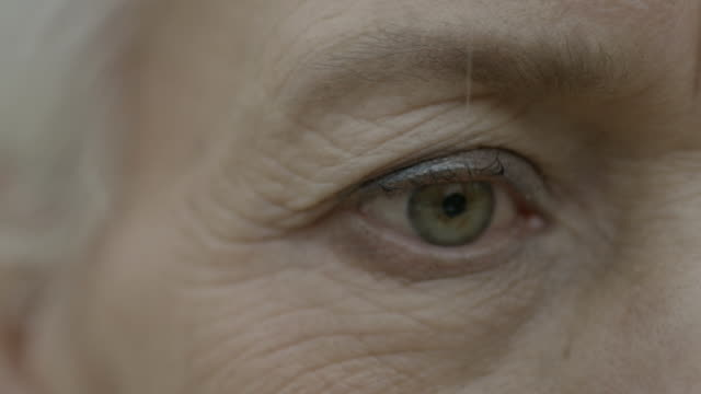 close shot of a women's right eye. - aging process stock videos & royalty-free footage
