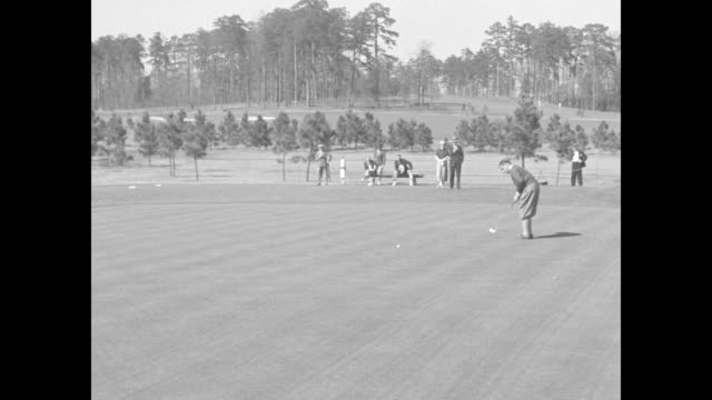 close shot of bobby jones waiting to putt at the augusta national invitational tournament / jones putting / overhead shot of jones walking away from... - amateur stock videos & royalty-free footage