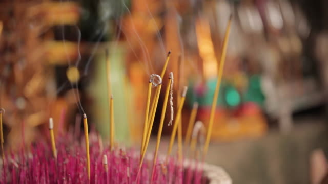 close shot of burning incense sticks. - cambodia stock videos and b-roll footage