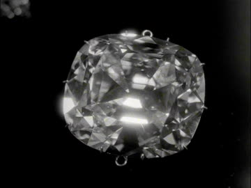 stockvideo's en b-roll-footage met close shot of cullinan diamond before it is re-attached to the st edwards crown in preparation for the coronation of elizabeth the second. 1953. - kostbare edelsteen