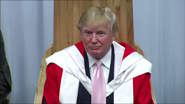 close shot of donald trump wearing a robe at a ceremony presenting him with an honorary degree from the robert gordon university aberdeen - ceremonial robe stock videos and b-roll footage