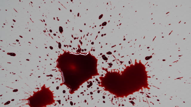 vídeos y material grabado en eventos de stock de close shot of fake blood being dropped onto a piece of white paper. - sangre
