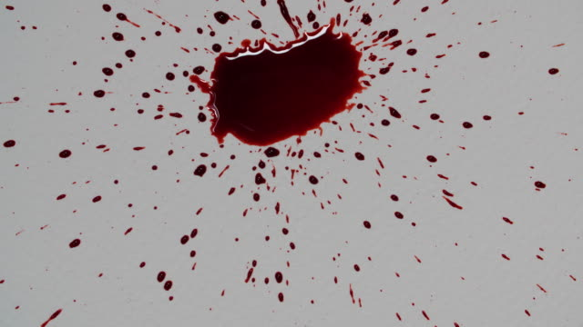 close shot of fake blood being dropped onto a piece of white paper. - crime and murder stock videos & royalty-free footage