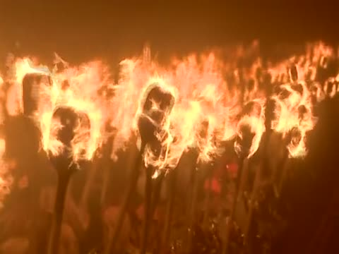 Close shot of flaming torches during the Up Helly Aa festival