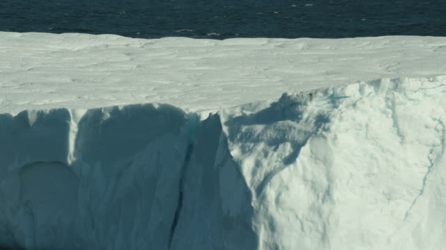 close shot of flat arctic iceberg - arctic stock videos and b-roll footage