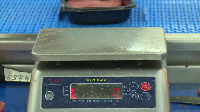 close shot of fresh tuna steaks being weighed in a factory - scales stock videos & royalty-free footage