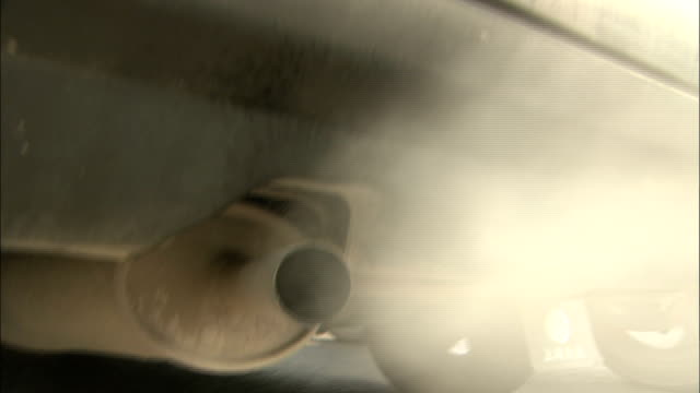 Close shot of fumes coming from car exhaust