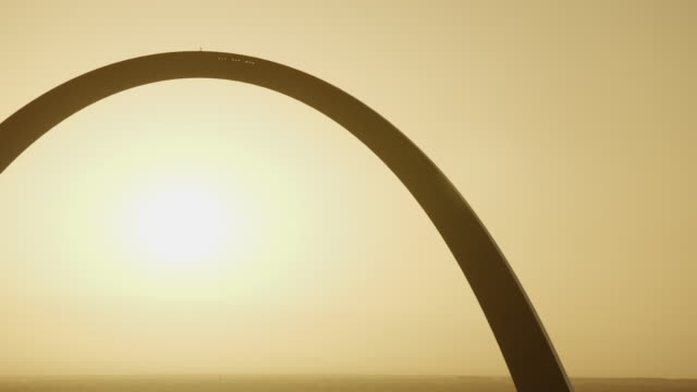 close shot of gateway arch at sunrise - arch architectural feature stock videos and b-roll footage