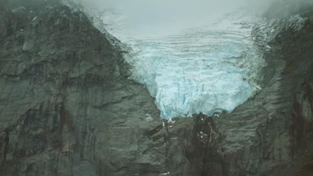 close shot of glacier and cliffs - grau stock-videos und b-roll-filmmaterial