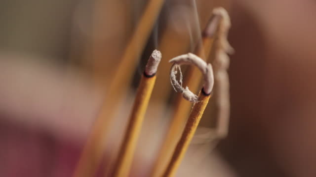 close shot of incense sticks. - incense stock videos & royalty-free footage