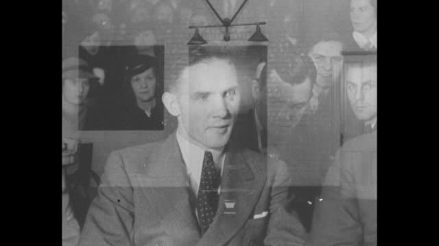 close shot of lindbergh baby case defendant bruno hauptmann sitting in courtroom, people sitting behind him / shot of electric chair, large question... - electric chair stock videos & royalty-free footage