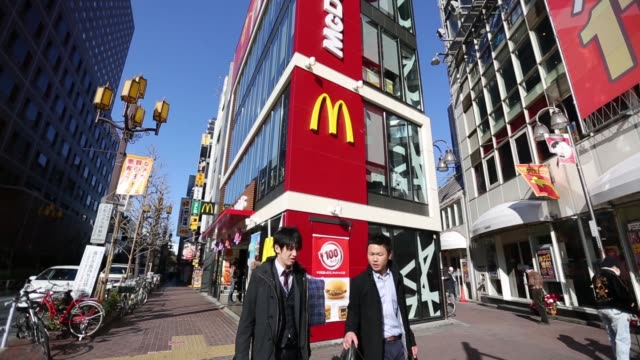 Close shot of McDonald's logo displayed outside a building Tilt down from a company logo displayed outside a McDonald's restaurant operated by...