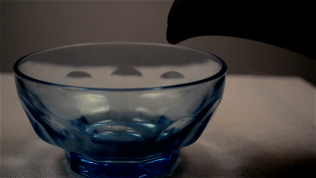 close shot of pouring green tea in a tea container. - tea pot stock videos and b-roll footage