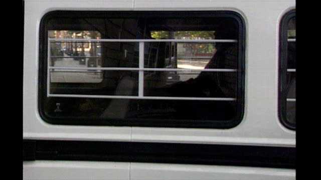 ext close shot of prison security van containing bint into old bailey - オールドベイリー点の映像素材/bロール