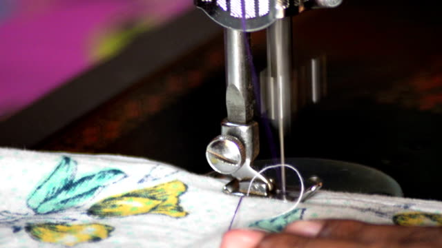 close shot of sewing using sewing machine. - 技能点の映像素材/bロール