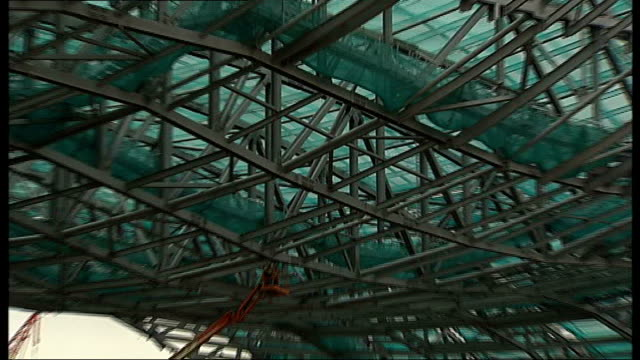 close shot of steel girders of aquatic centre roof pull out to gv - metal blend stock videos and b-roll footage