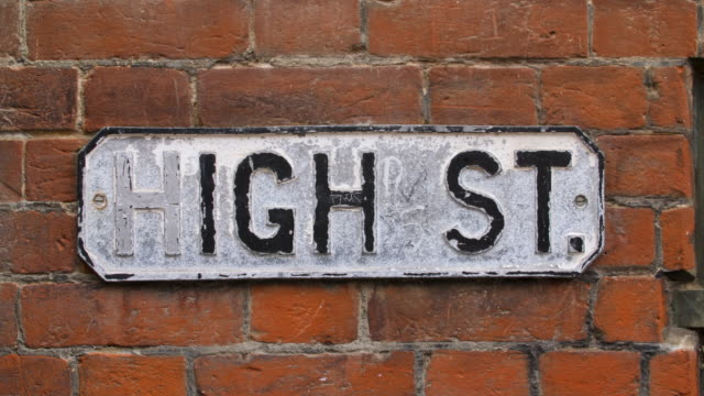 Close shot of street sign for Canterbury's High Street.