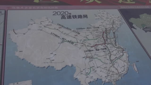 Close shot of the construction plan of the new Xingjiang high speed train LanzhouXinjiang HighSpeed Rail Line printed on a large board of map Zooms...