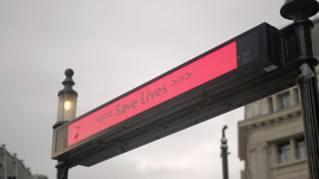 close shot of the covid19 safety alert in oxford circus london - public transport stock videos & royalty-free footage