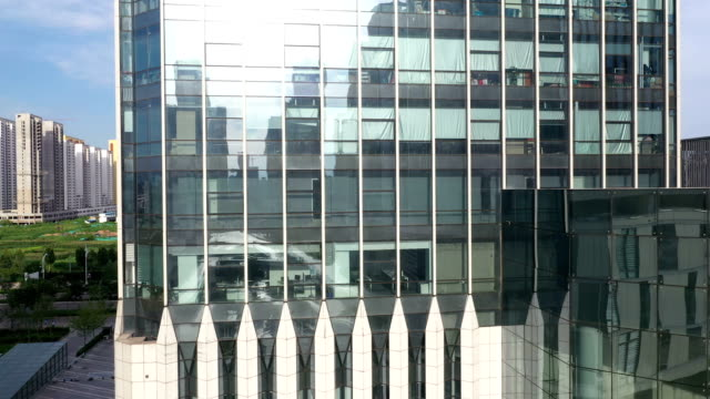 close shot of the glass curtain wall and windows of the building - curtain wall facade stock videos and b-roll footage