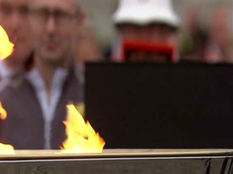 close shot of the olympic flame burning in cauldron - flaming torch stock videos & royalty-free footage