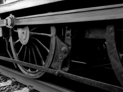 close shot of wheels of a steam train starting to move along a train track 1965 - steam train stock videos & royalty-free footage