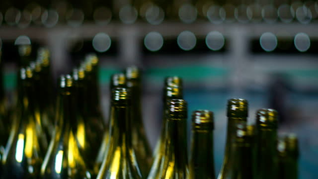 close shot of wine bottles in bottling factory - bottle stock videos & royalty-free footage