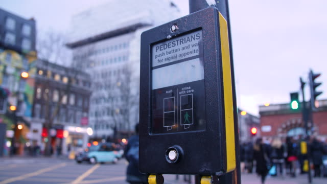 Close shot on a pedestrian crossing on London's Euston Road.