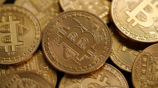 close shot on a pile of bitcoins as they slowly revolve. - bitcoin stock videos & royalty-free footage