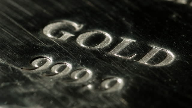 Close shot on the engravings on a gold bar.
