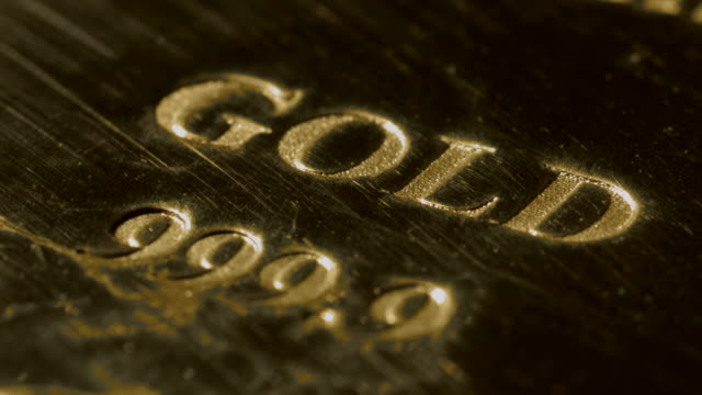 Close shot on the lettering stamped onto a gold bar.