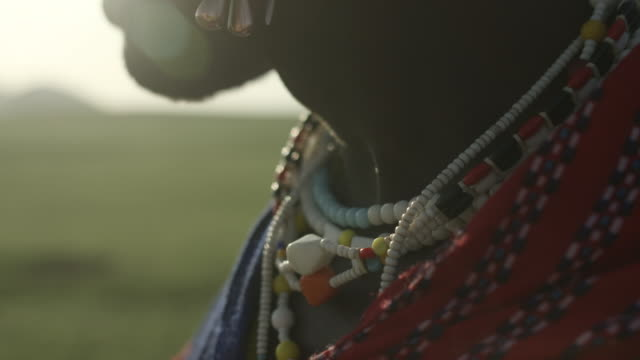 close shot on the necklaces worn by a masai tribesman. - masai stock videos and b-roll footage