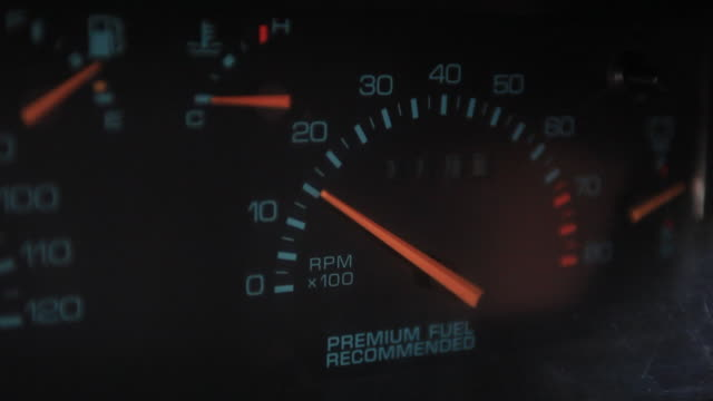 close shot on the needle of a tachometer moving as the car is revved. - speedometer stock videos & royalty-free footage