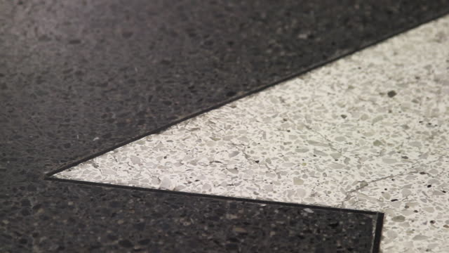 close shot panning across a granite floor. - granite stock videos and b-roll footage