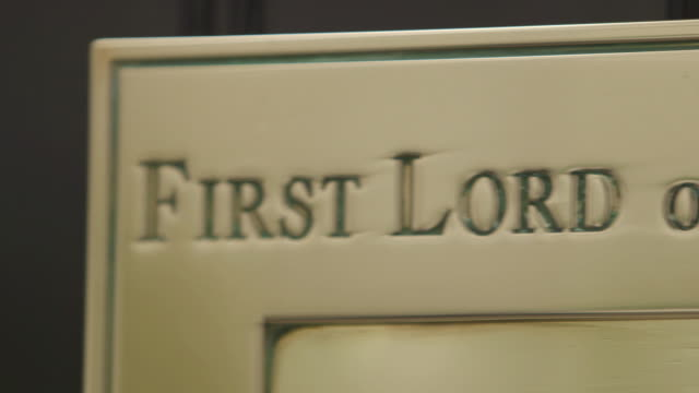 close shot panning across the words engraved on the letter box of ten downing street. - prime minister stock videos & royalty-free footage