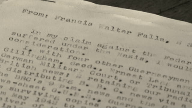 Close shots of typewritten compensation claim written by Frank Falla
