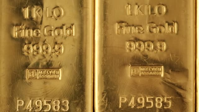 Close shots one kilogram gold bars at Gold Investments Ltd bullion dealers in London Gold and silver bars on April 04 2013 in London