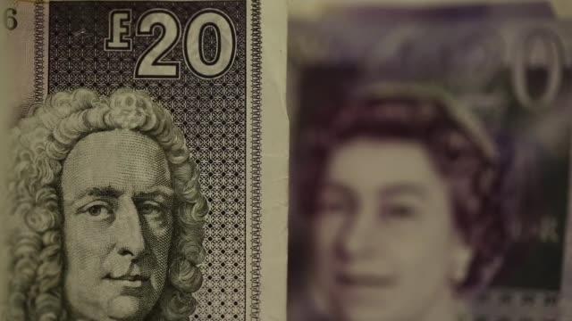 Close shots Royal Bank of Scotland Group Plc pound sterling banknotes sit among Bank of England 20 pound sterling banknotes and 20 euro banknotes...