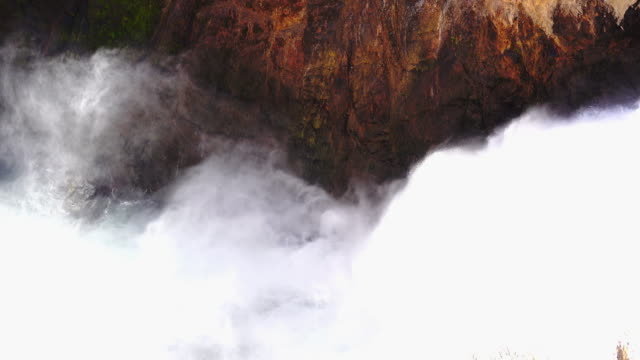 close to the waterfall in yellowstone national park - grand canyon video stock e b–roll