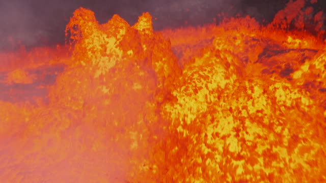 close tracking shot following bursts of lava as they shoot from a lava lake in a volcano on ambrym, vanuatu [filmed at 50fps and maintained at half speed]. - vulkanausbruch stock-videos und b-roll-filmmaterial