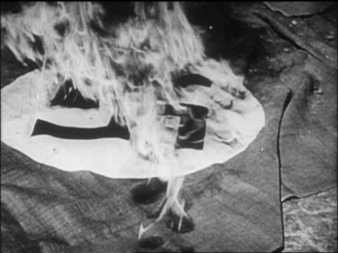 B/W close up 1945 close up Nazi flag burning / newsreel