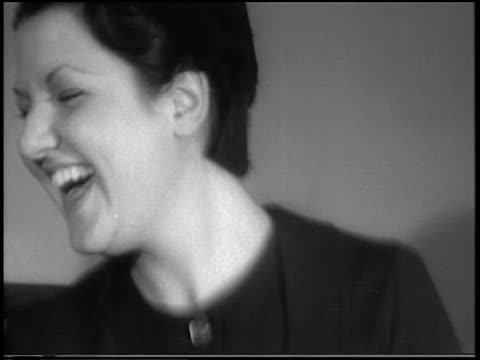 b/w 1933 close up pan 2 laughing women bouncing in vibration-tester experiment / indiana / newsreel - 1933 stock videos & royalty-free footage