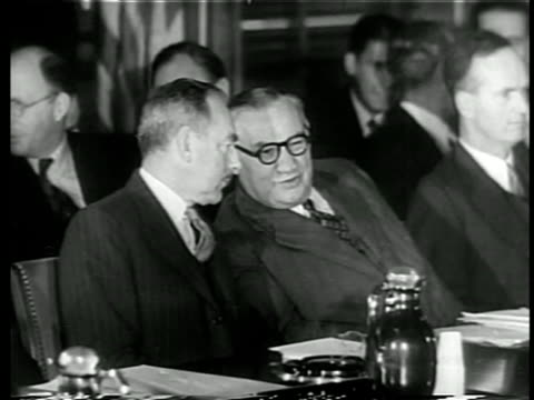 b/w 1949 close up 2 members of north atlantic council talking at nato meeting / documentary - whispering stock videos & royalty-free footage