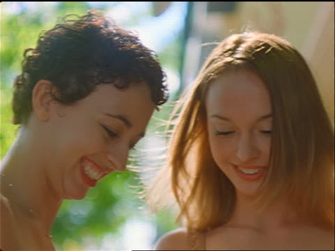 vídeos de stock, filmes e b-roll de close up 2 smiling teens (1 black) looking down outdoors / east village, nyc - only teenage girls