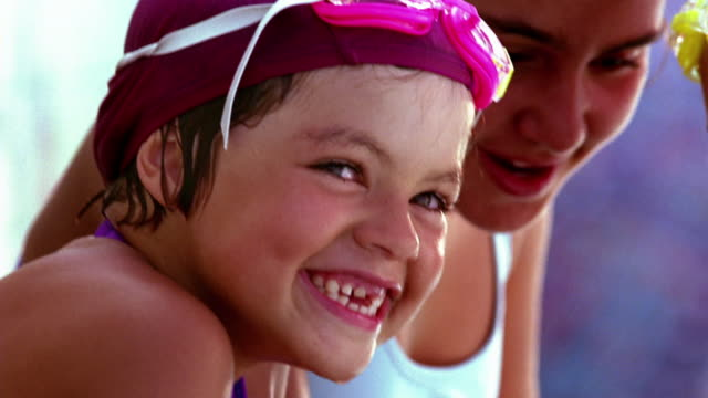 close up 3 girls in bathing caps, swimsuits, and goggles talking + laughing - swimming goggles stock videos & royalty-free footage