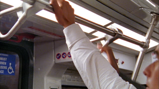 close up 3 hands grabbing railing in subway - gripping stock videos and b-roll footage
