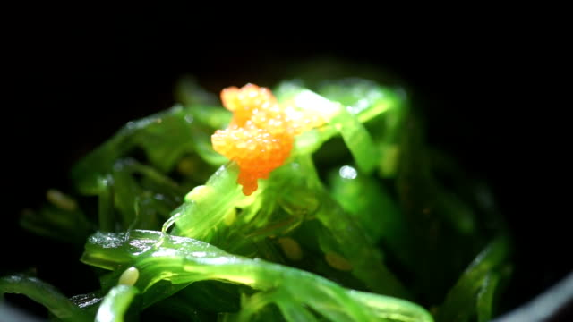 close up a fresh seaweed salad : japanese food. - seaweed stock videos & royalty-free footage