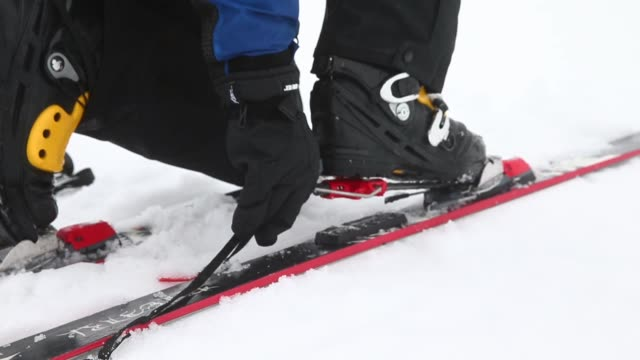 close up a man puts on telemark skis - telemark stock videos and b-roll footage