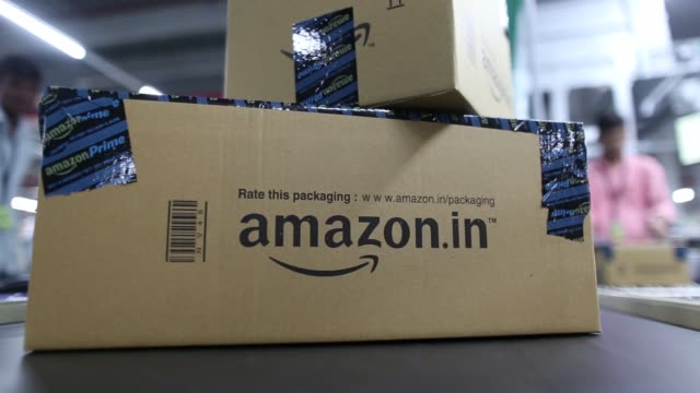 Close up a package moves along a conveyor belt at the Amazoncom Inc fulfillment center in Hyderabad India on Thursday Sept 7 2017