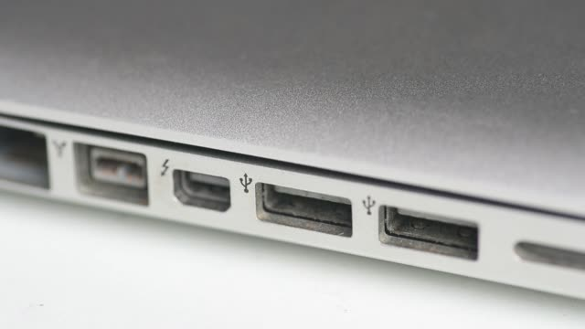 Close up a Thunderbolt and USB ports are seen on an Apple Inc MacBook Pro laptop computer in an arranged video shot in Bangkok Thailand on Friday...